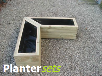 View sets of wooden planters.
